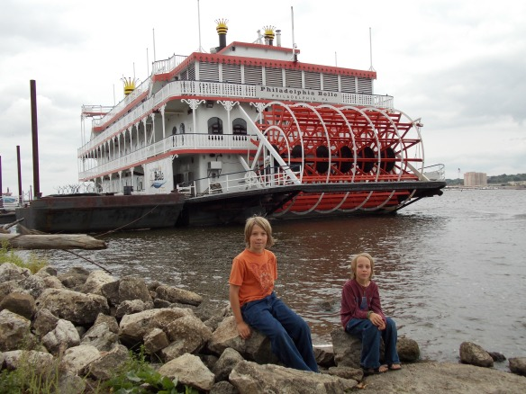 Logan & Cole in front of paddle wheel boat in Moline, IL.
