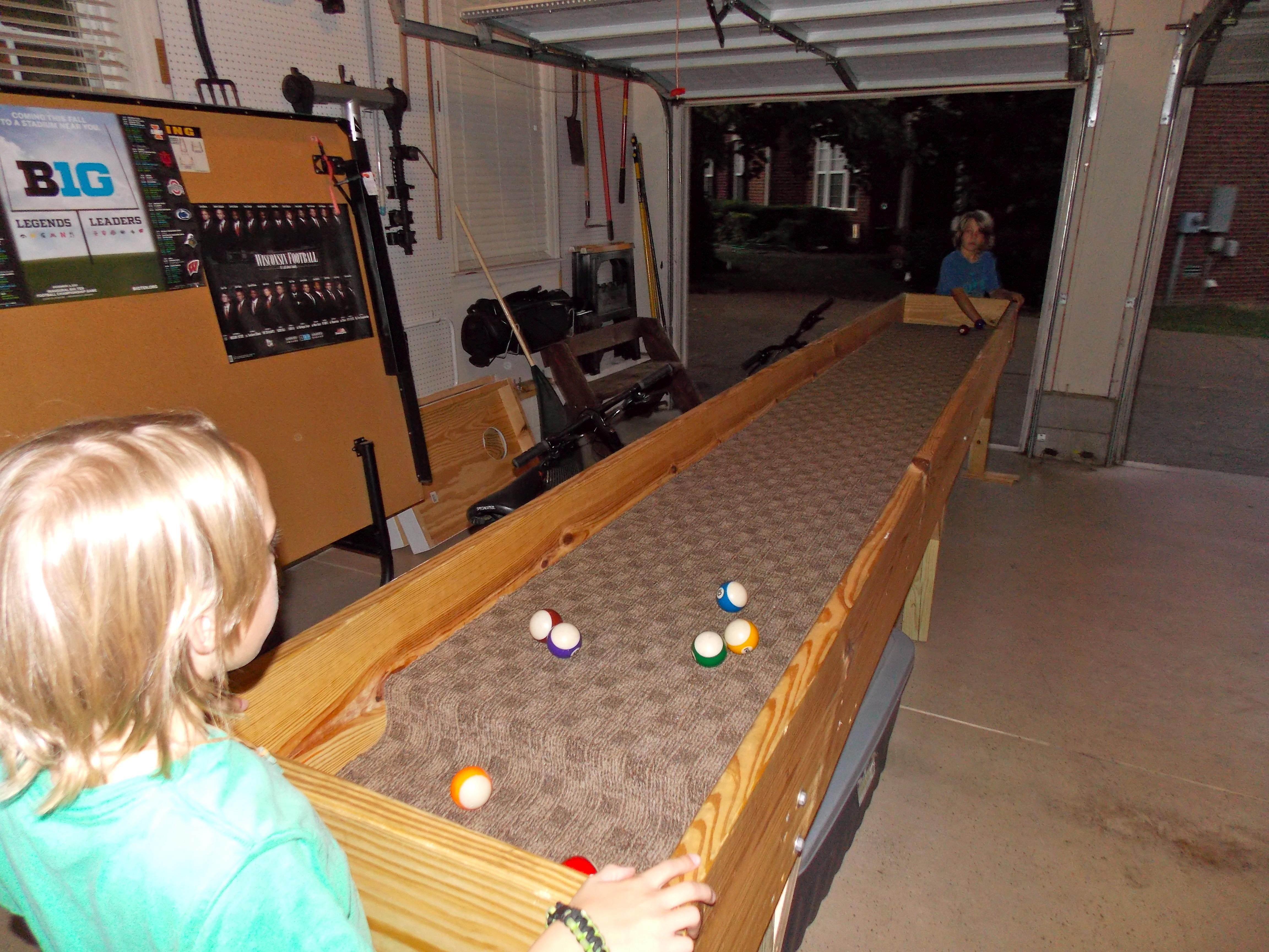 cole u0026 logan playing carpetball - Carpet Ball Table