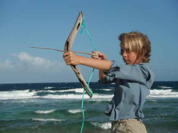 Cole with bow & arrow he made on the beach.