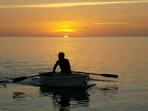 "David rowing to Truansea for supper.  ""The real deal sailor,"" as the boys call him."
