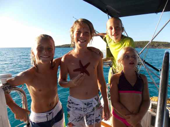 We are all happy that some cruising kids are holed up at Black Point with us.  They love to dive off the bow of the boat, swim around to the transom, walk the side decks to the front of the boat and do it all over again and again and again!  Happy,tired kids and parents at night.