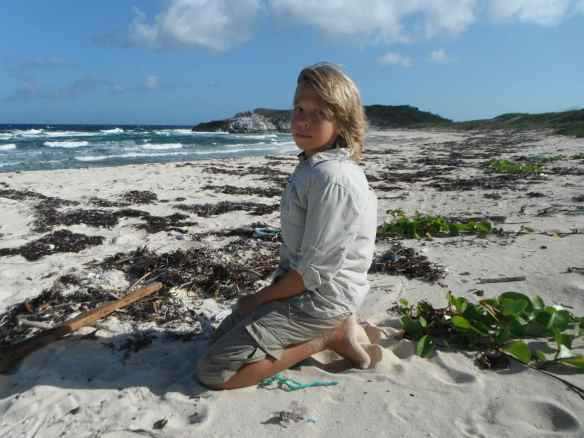 Logan on one of our beach exploration days.  I found my first hamburger bean this day!