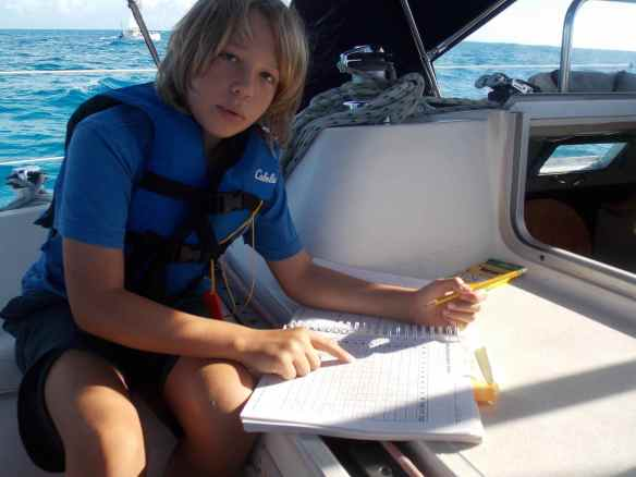 Logan doing school work on Truansea on the way to Black Point on Great Guana Cay.