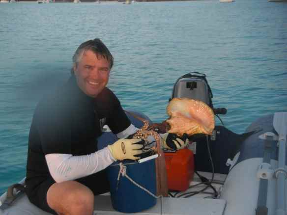 Mark with the catch of the day, 2 lobster and 1 conch.