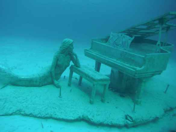 Mermaid at grand piano.