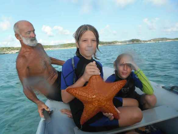 The starfish are big and beautiful.  David, Logan and Cole.