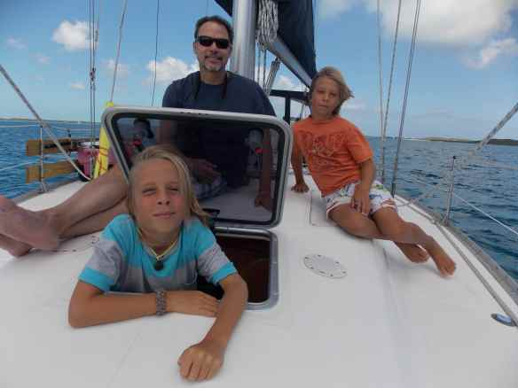 Bill, Logan & Cole on the bow.  The boys love popping in and out of the v-berth hatch.