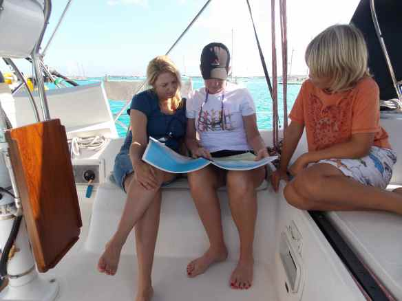 Tawny and Valerie studying our Explorer chart of the area.