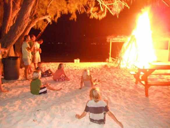 Boys at a bonfire on Hamburger Beach (Big D's).