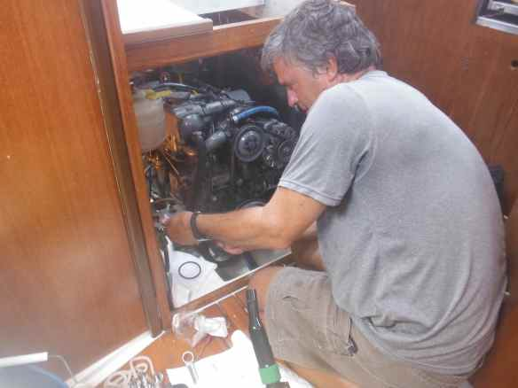 Mark working on the engine.  He loves the 5 sided engine access on Truansea!