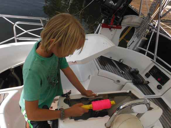 Cole helping with a wiring project on Commotion, a friend's boat in Fort Lauderdale.