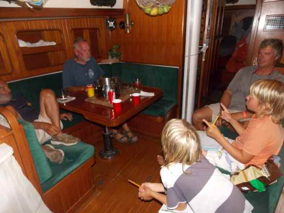 Dave is on the left and Dennis is seated next to him.  This picture was taken inside their boat.