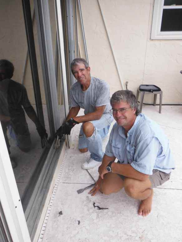 Mark and Tom working on Tom's sliding patio door.