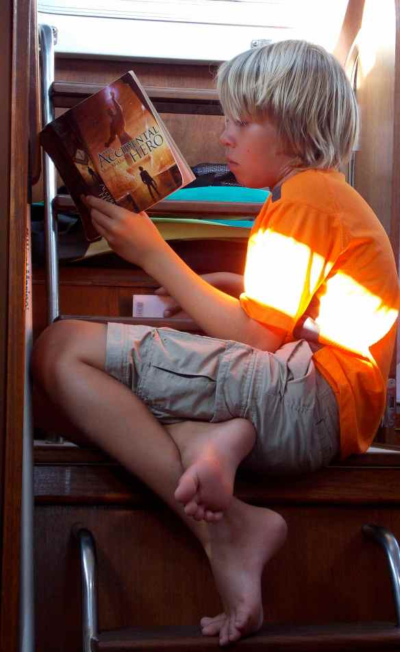 Logan hanging out reading a book his friend Max sent him.