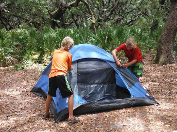 Logan and Cole setting up their tent.