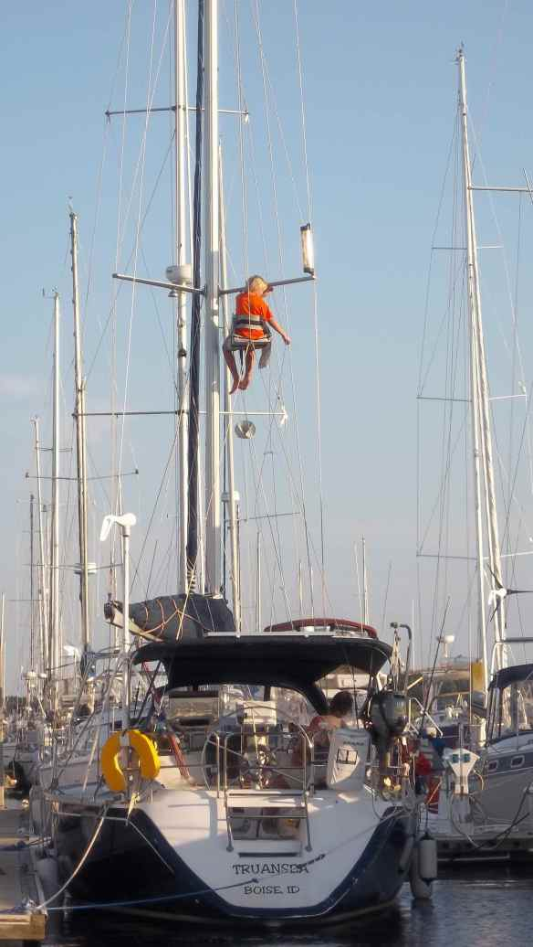 Logan replacing the flag halyard.