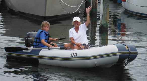 Logan taking Marty for a dinghy ride.