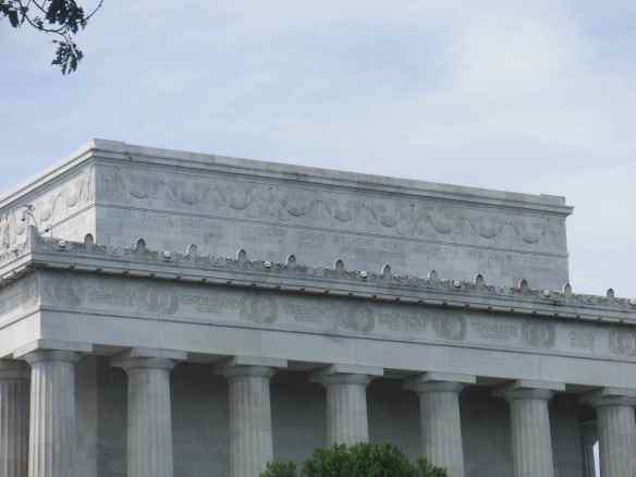 There is Idaho on the top row of the Lincoln Memorial building.