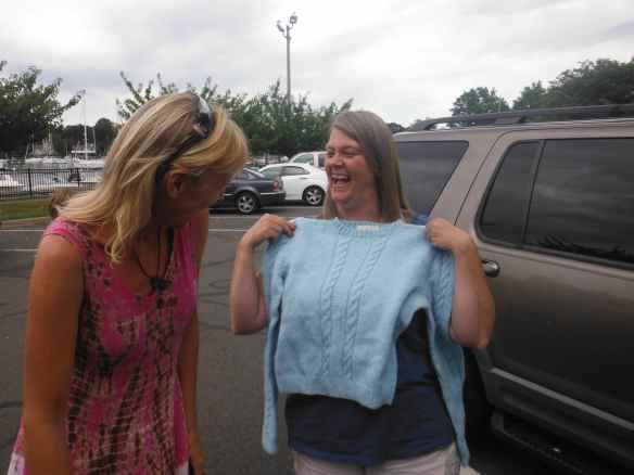 Kellie, an old high school classmate, shows me the sweater she found in her chest that I knitted for her our senior year in high school.