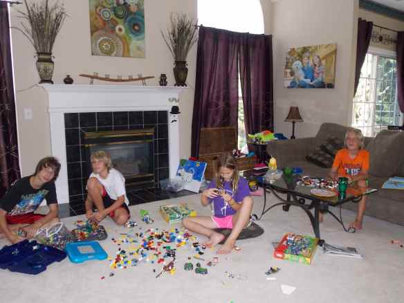 Jake and Ashley (second cousins) building Legos with Logan and Cole.