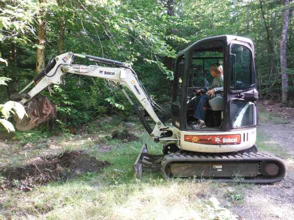 Logan running the Bobcat.