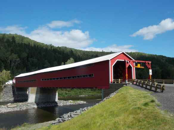 Covered bridge over river between New Brunswick and Quebec.